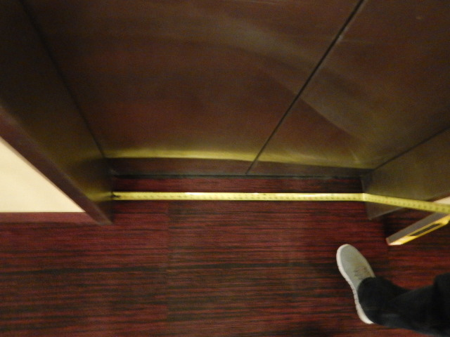 Accessibility specialist measuring width of elevator