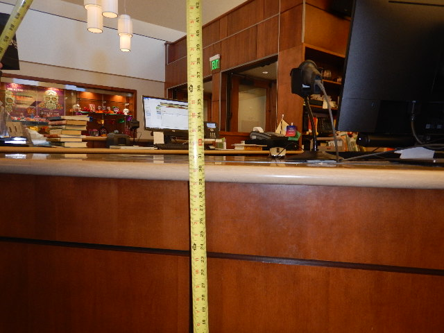 Tape measure used to measure the height of a lobby service desk