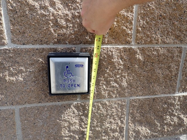 Tape measure used to measure the height of a push button