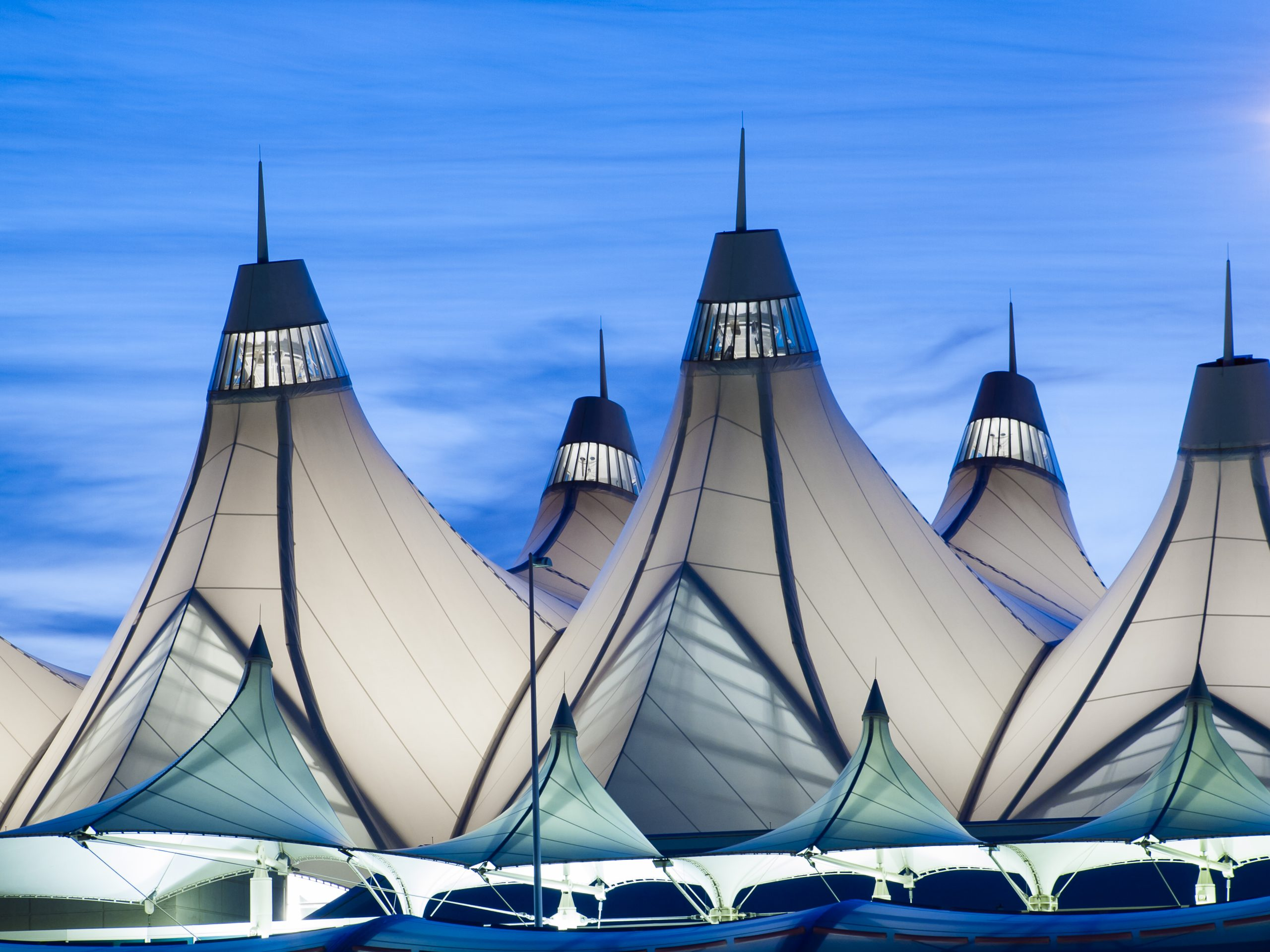 Denver International Airport well known for peaked roof. Design of roof is reflecting snow-capped mountains.